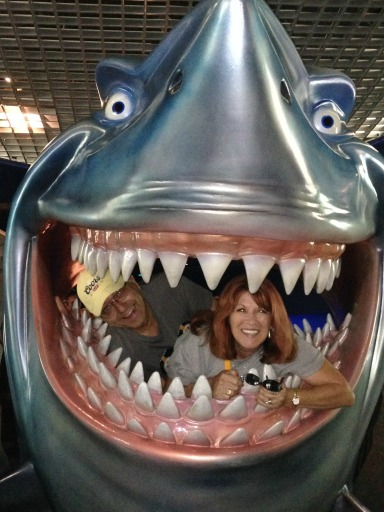 At Epcot, the smiles were contagious. (Dad, Mom, and Bruce the Shark)